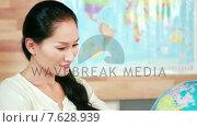 Купить «Casual businesswoman looking at earth globe», видеоролик № 7628939, снято 18 июля 2019 г. (c) Wavebreak Media / Фотобанк Лори