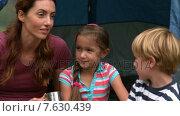 Купить «Happy mother with her children on a camping trip», видеоролик № 7630439, снято 17 июля 2019 г. (c) Wavebreak Media / Фотобанк Лори