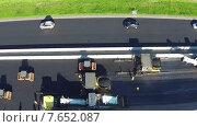 Купить «Вид с воздуха на ремонт дорог», видеоролик № 7652087, снято 7 июля 2015 г. (c) Discovod / Фотобанк Лори