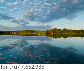 Купить «Reflection of clouds on water, Lake of The Woods, Ontario, Canada», фото № 7652935, снято 15 июля 2013 г. (c) Ingram Publishing / Фотобанк Лори