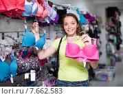 Купить «Woman buying brassiere», фото № 7662583, снято 19 июля 2019 г. (c) Яков Филимонов / Фотобанк Лори