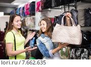 Купить «girl selecting handbag in commercial centre», фото № 7662635, снято 17 октября 2018 г. (c) Яков Филимонов / Фотобанк Лори