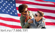 Купить «happy multiracial couple over american flag», фото № 7666191, снято 19 марта 2015 г. (c) Syda Productions / Фотобанк Лори