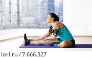 Купить «smiling woman stretching leg on mat over gym», фото № 7666327, снято 7 июня 2014 г. (c) Syda Productions / Фотобанк Лори
