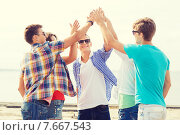 Купить «group of smiling friends making high five outdoors», фото № 7667543, снято 10 августа 2014 г. (c) Syda Productions / Фотобанк Лори