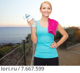 Купить «happy woman with water bottle and towel outdoors», фото № 7667599, снято 7 января 2014 г. (c) Syda Productions / Фотобанк Лори
