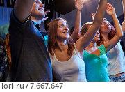 Купить «smiling friends at concert in club», фото № 7667647, снято 20 октября 2014 г. (c) Syda Productions / Фотобанк Лори