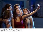 Купить «friends with smartphone taking selfie in club», фото № 7667651, снято 20 октября 2014 г. (c) Syda Productions / Фотобанк Лори