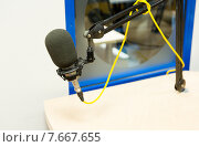 Купить «microphone at recording studio or radio station», фото № 7667655, снято 8 апреля 2015 г. (c) Syda Productions / Фотобанк Лори