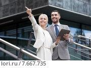 Купить «smiling businessmen with tablet pc outdoors», фото № 7667735, снято 19 августа 2014 г. (c) Syda Productions / Фотобанк Лори
