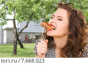 Купить «hungry young woman eating meat on fork over house», фото № 7668023, снято 3 января 2010 г. (c) Syda Productions / Фотобанк Лори