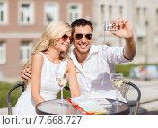 Купить «couple taking photo in cafe», фото № 7668727, снято 14 июля 2013 г. (c) Syda Productions / Фотобанк Лори