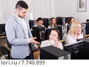 Купить «boss and clerk at open space working area», фото № 7740899, снято 19 октября 2018 г. (c) Яков Филимонов / Фотобанк Лори