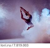 Купить «Beautiful young ballet dancer jumping on a lilac background.», фото № 7819003, снято 19 февраля 2019 г. (c) PantherMedia / Фотобанк Лори