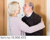 Купить «Mature wife meeting husband near door», фото № 8000415, снято 24 сентября 2018 г. (c) Яков Филимонов / Фотобанк Лори