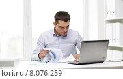 Купить «busy businessman with laptop and papers in office», видеоролик № 8076259, снято 8 июля 2015 г. (c) Syda Productions / Фотобанк Лори