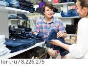 Купить «Couple choosing denim in store», фото № 8226275, снято 21 августа 2018 г. (c) Яков Филимонов / Фотобанк Лори