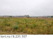 Купить «Унылый серый пейзаж с недостроенными серыми зданиями», эксклюзивное фото № 8231107, снято 20 июля 2015 г. (c) Дмитрий Абушкин / Фотобанк Лори