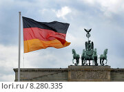 Купить «Berlin, Germany, Germany flag in front of the Brandenburg Gate», фото № 8280335, снято 1 апреля 2012 г. (c) Caro Photoagency / Фотобанк Лори