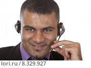 Купить «Portrait of Young male call center agent with headset », фото № 8329927, снято 24 января 2019 г. (c) PantherMedia / Фотобанк Лори