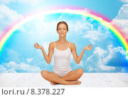 Купить «woman meditating in yoga lotus pose», фото № 8378227, снято 16 сентября 2012 г. (c) Syda Productions / Фотобанк Лори