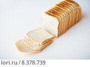 Купить «close up of white sliced toast bread on table», фото № 8378739, снято 22 мая 2015 г. (c) Syda Productions / Фотобанк Лори