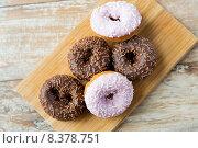Купить «close up of glazed donuts pile on table», фото № 8378751, снято 21 мая 2015 г. (c) Syda Productions / Фотобанк Лори