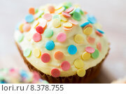 Купить «close up of glazed cupcake or muffin on table», фото № 8378755, снято 21 мая 2015 г. (c) Syda Productions / Фотобанк Лори