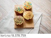 Купить «close up of glazed cupcakes or muffins on table», фото № 8378759, снято 21 мая 2015 г. (c) Syda Productions / Фотобанк Лори