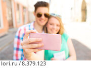 Купить «happy couple taking selfie with smartphone in city», фото № 8379123, снято 7 июля 2014 г. (c) Syda Productions / Фотобанк Лори