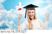 Купить «student in trencher cap with diploma over blue sky», фото № 8379527, снято 30 марта 2013 г. (c) Syda Productions / Фотобанк Лори