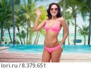 Купить «happy woman in sunglasses and bikini on beach», фото № 8379651, снято 14 апреля 2015 г. (c) Syda Productions / Фотобанк Лори