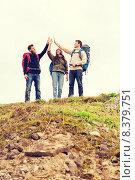Купить «group of smiling friends with backpacks hiking», фото № 8379751, снято 31 августа 2014 г. (c) Syda Productions / Фотобанк Лори