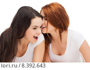 Купить «two smiling girls whispering gossip», фото № 8392643, снято 27 ноября 2013 г. (c) Syda Productions / Фотобанк Лори