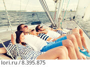 Купить «smiling friends lying on yacht deck», фото № 8395875, снято 13 июля 2014 г. (c) Syda Productions / Фотобанк Лори
