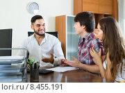 Купить «Salesman talking about contract with couple», фото № 8455191, снято 21 сентября 2018 г. (c) Яков Филимонов / Фотобанк Лори