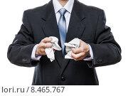 Купить «Проблемы и неудачи в бизнесе - сердитый бизнесмен рвет в клочья бумажный документ», фото № 8465767, снято 18 апреля 2015 г. (c) Илья Андриянов / Фотобанк Лори