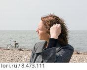 Купить «Красивая женщина на берегу моря», фото № 8473111, снято 6 апреля 2013 г. (c) Олег Хархан / Фотобанк Лори