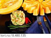 Купить «Салат с рисом, дыней и ветчиной», эксклюзивное фото № 8480135, снято 20 июля 2015 г. (c) Blekcat / Фотобанк Лори