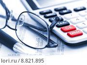 Купить «Tax calculator pen and glasses», фото № 8821895, снято 23 апреля 2019 г. (c) PantherMedia / Фотобанк Лори