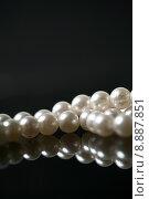 Купить « Beautiful white pearl necklace over black background», фото № 8887851, снято 16 октября 2018 г. (c) PantherMedia / Фотобанк Лори