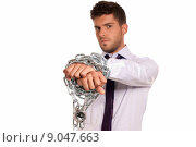 Купить «Businessman chained with padlock, job slave symbol, isolated on white background», фото № 9047663, снято 16 декабря 2018 г. (c) PantherMedia / Фотобанк Лори