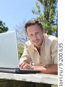 Купить «Man using laptop computer on a pontoon», фото № 9200635, снято 20 января 2019 г. (c) PantherMedia / Фотобанк Лори