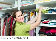 Купить «Female choosing apparel at store», фото № 9266051, снято 30 марта 2020 г. (c) Яков Филимонов / Фотобанк Лори