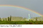 Купить «Дождь и радуга на фоне трамплина на финском курорте Ruka, Куусамо», фото № 9267051, снято 8 июля 2015 г. (c) Валерия Попова / Фотобанк Лори