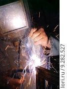 Купить «A welder using a mig torch to attach two pieces of metal.», фото № 9282527, снято 22 марта 2019 г. (c) PantherMedia / Фотобанк Лори
