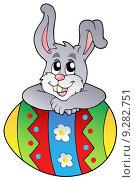 Купить «Easter egg with cute lurking bunny», иллюстрация № 9282751 (c) PantherMedia / Фотобанк Лори