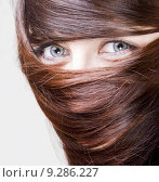 Купить «woman with hair around the eyes», фото № 9286227, снято 20 января 2020 г. (c) PantherMedia / Фотобанк Лори