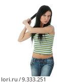 Купить «Young atractive girl with scary mine trying to hit something with sword,isolated », фото № 9333251, снято 22 июля 2019 г. (c) PantherMedia / Фотобанк Лори