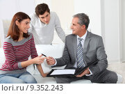 Купить «Young couple sigining renting contract with real estate agent», фото № 9352243, снято 5 декабря 2019 г. (c) PantherMedia / Фотобанк Лори